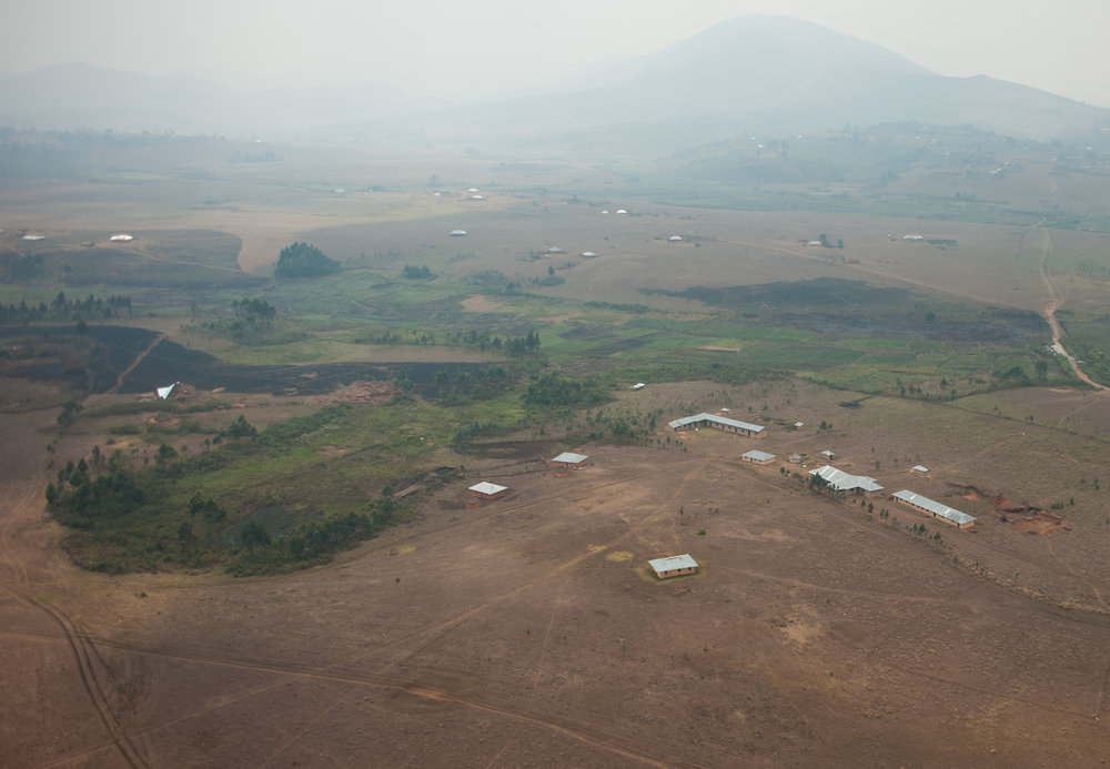 Ariel view of Eben-Ezer University (four buildings in a row, bottom right of the frame) and the guest house (far left center of the frame, half of a roof in place) that Michael and Lisa will be moving into in a few years.