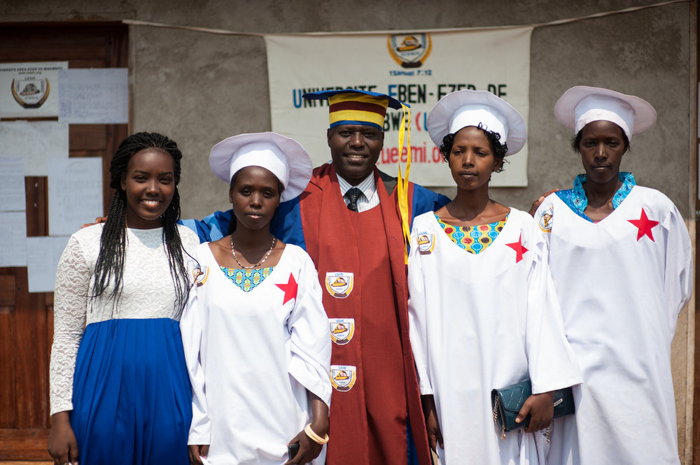 A shot of Lazare, Jolie, and the three female graduates.        Jolie's grandpa and his brothers walked a TWO DAY journey to visit her when word got out that she was in Minembwe!