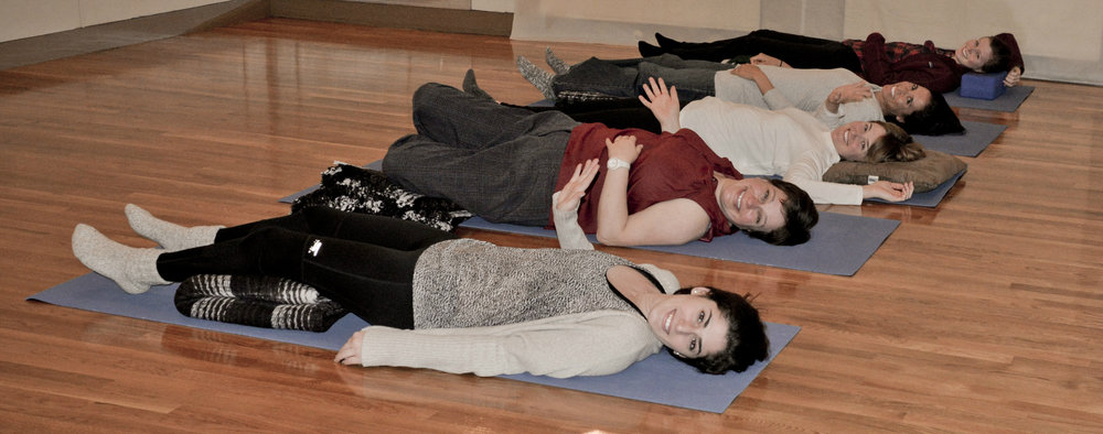 These meditators are demonstrating that meditation can be done in a lying down position.  You don't have to always be seated!    Thanks to Studio-ish for taking pictures of our relaxed meditation students at the end of the Meditation Toolbox course last winter.