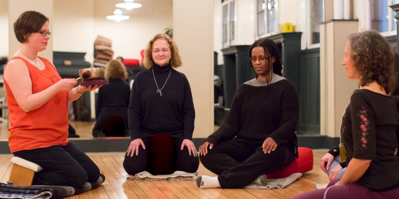 Sometimes we sit on the floor for meditation during the CMN.