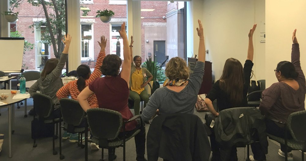 A chair yoga stretching routine is a fun part of the retreat day. Picture taken during our November 2017 Bypassing Burnout Workshop at the NonProfit Center, Financial District, Boston.