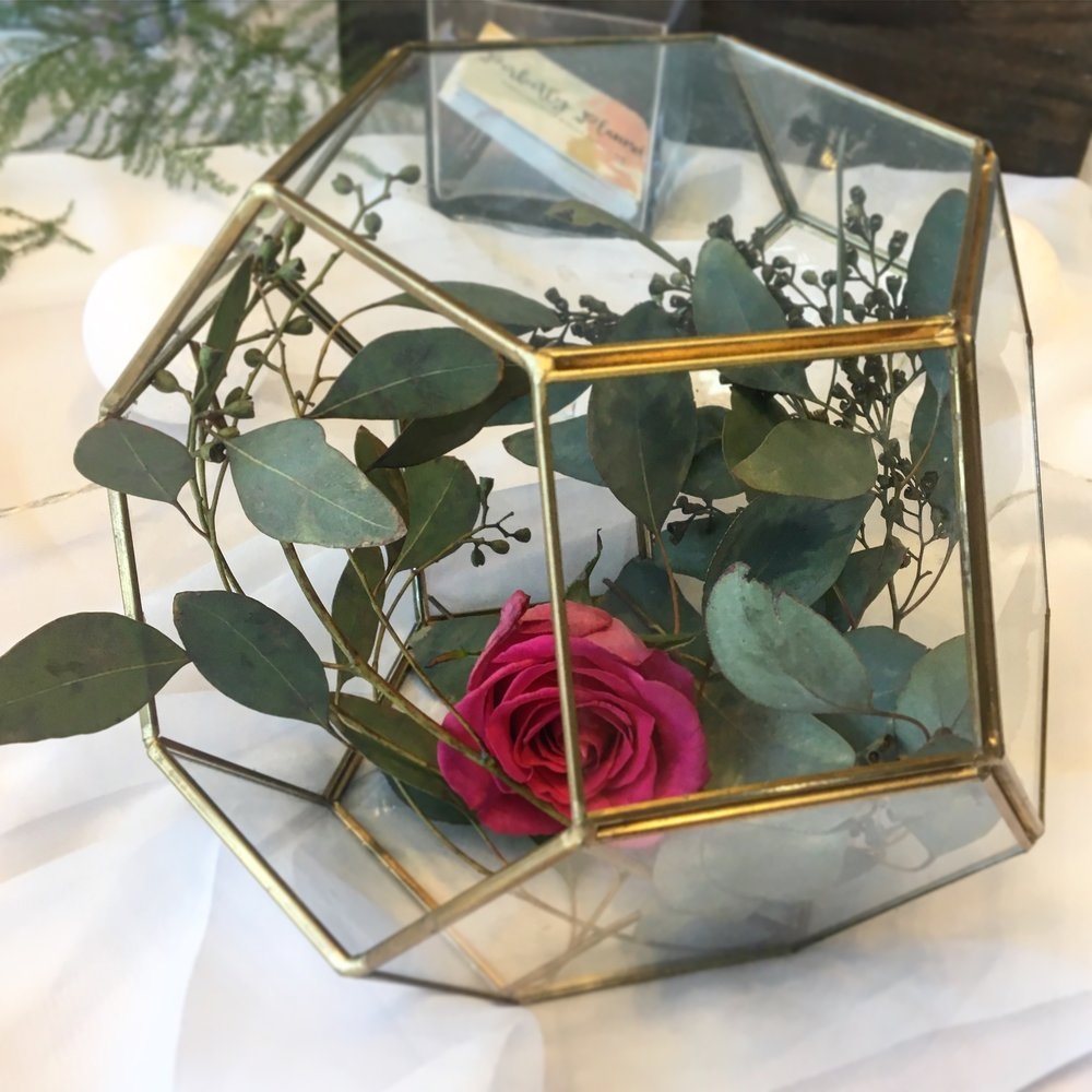 Gold and glass terrarium