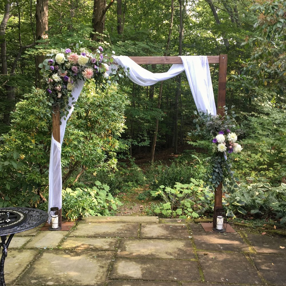 Wooden Ceremony Arch. Includes fabric, delivery, set-up, tear-down. $100 with any planning package. $220 on it's own.
