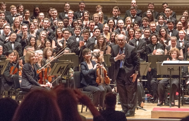 In April of 2015, The Glee Club and Chorus had the honor of singing the world premiere of Roberto Sierra's 'Cantares' in Carnegie Hall. Here is Roberto receiving a standing ovation from the audience.