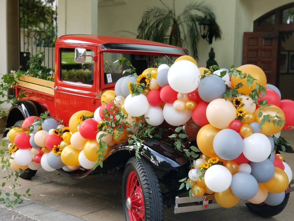 Balloon Sculpture Garland swag on car Zim Balloon Specialties.jpg
