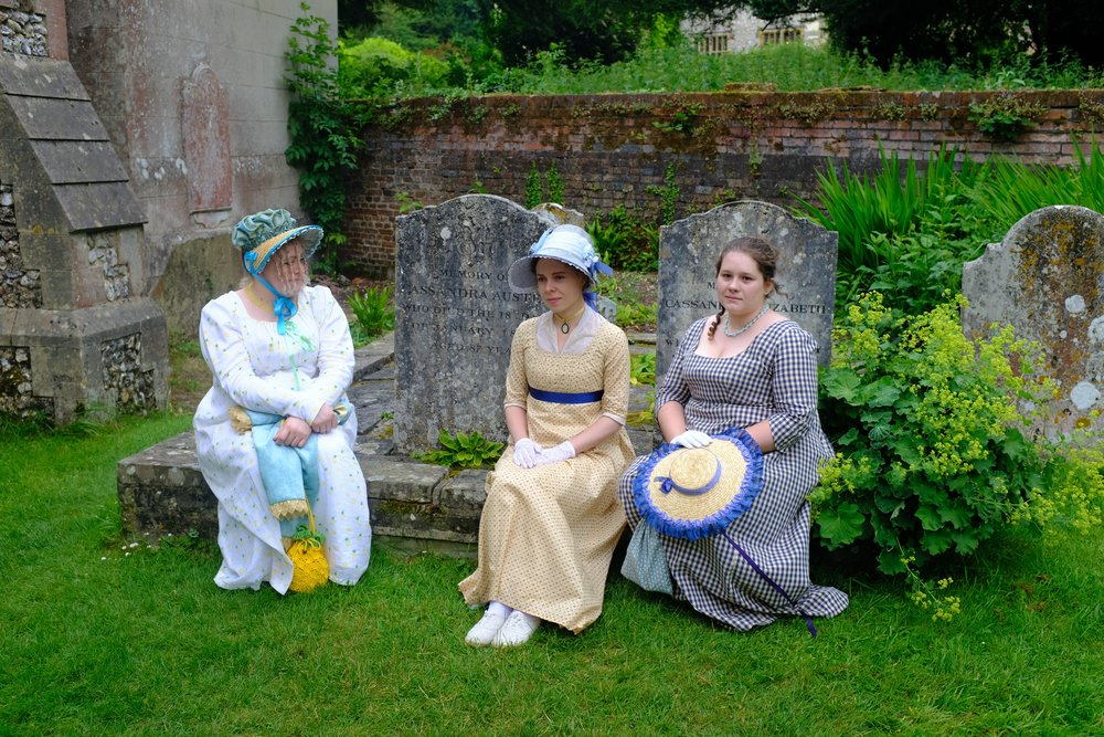 Three ladies at the gravestones of Jane's mother and sister