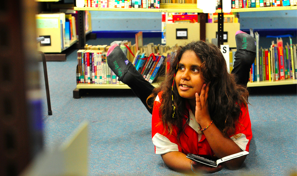 A student with her e-reader.  Credit: Indigenous Reading Project