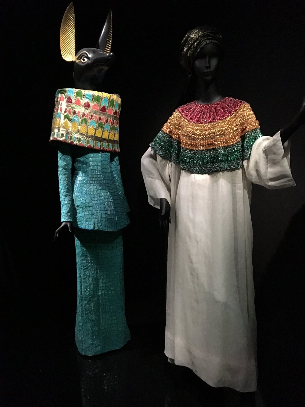 John Galliano stand-out creations are exhibited together with African and Ancient Egypt artifacts as sources of inspiration.