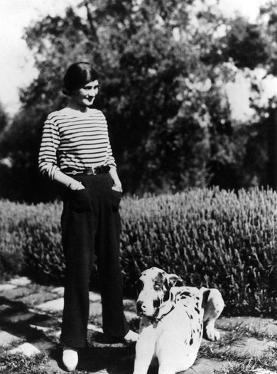 Coco Chanel with Gigot on the French Riviera.