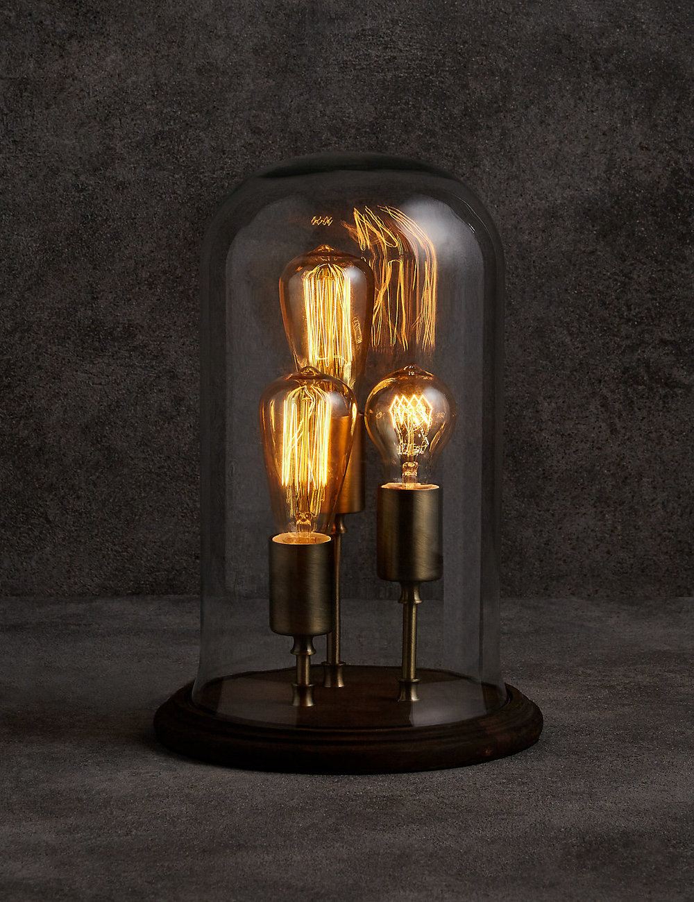 The  Evelyn Cloche Table Lamp  is so cool! It manages to look industrial as well as refined and would be a great addition to your home.