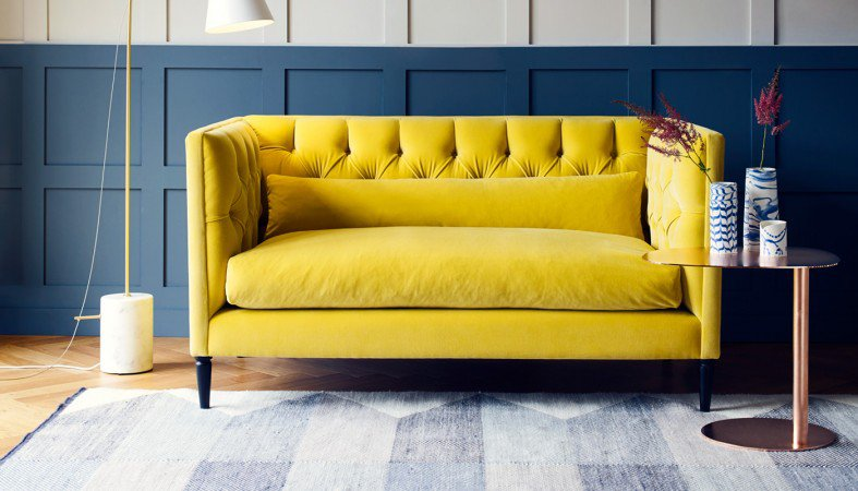 Rich yellow velvet... wow! A bold choice, but oh so inviting, especially when teamed with dark walls and neutral accessories. The sumptuous Balmoral sofa from  Heal's  will be a pop of sunshine during even the darkest winter months. A more formal style, with it's tall sides and deep-buttoning, it'll keep it's shape and still look good, even after a marathon of lounging.