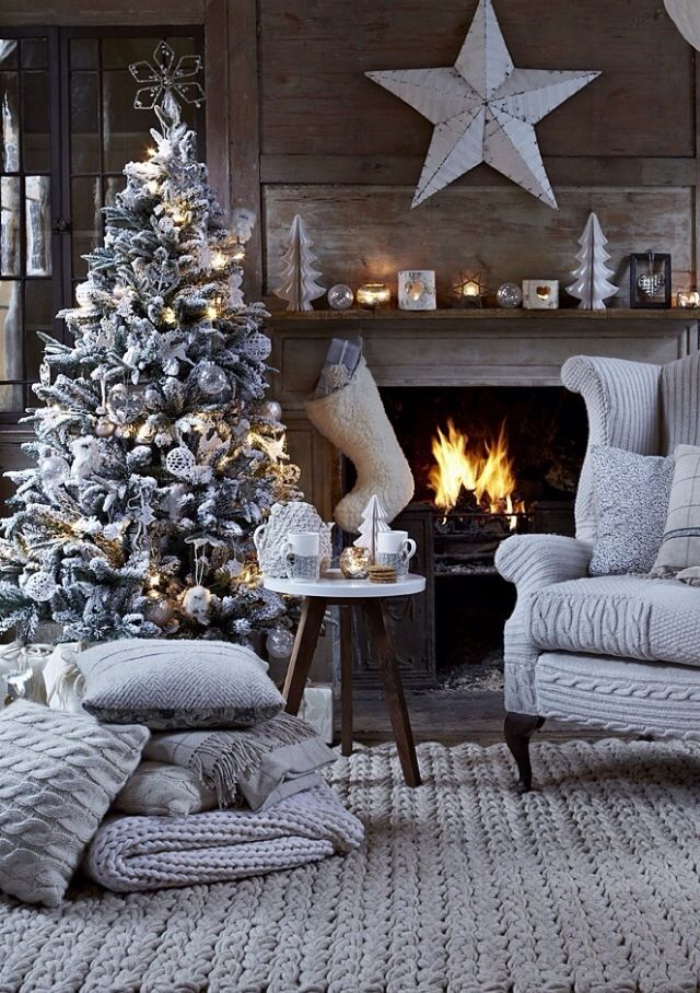 Or take your cue from nature and just as the cool frost gathers outside, choose hues of grey, white and wood for inside. Reaching out, you can feel the crisp snow on the tree. Warm things up with woollen fabrics and chunky knits. Pile up the cushions and throws and add warm lighting as counter balance.   Source: robbrooksrealty.com