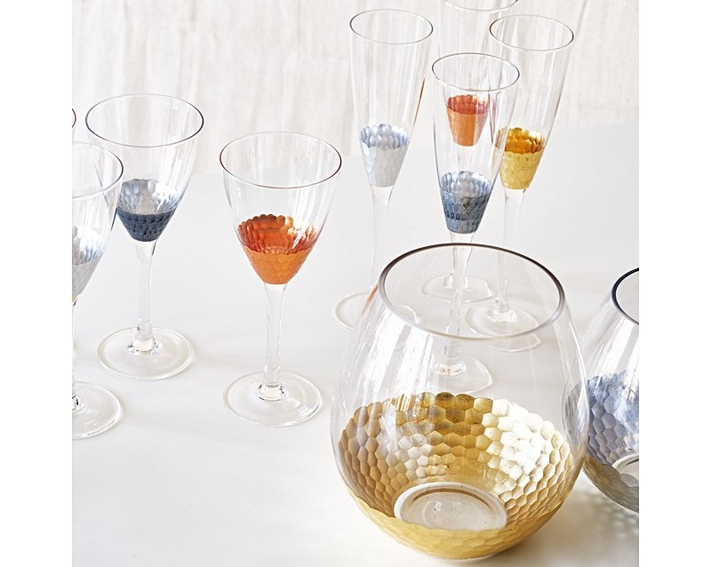 Invest is some glassware worth clinking! These mixed metallic glasses are too good to leave on the table.    Source:  Oliver Bonas