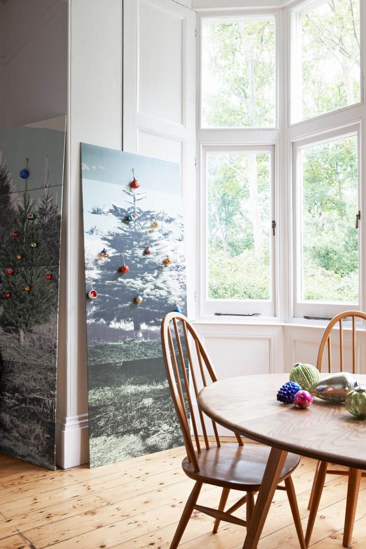 No space for a Christmas tree? Or perhaps you prefer something with a sense of fun? This wallpaper panel can fit in even the tiniest spots and with some baubles or a string of lights will be a festive work of art. Source: Deborah Bowness