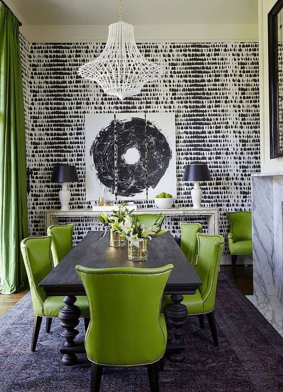 In this dining room, the vibrant green is matched by a strong monochrome palette in the rest of the room. This is needed to balance the colours and make the room not feel dominated by any one colour. It's modern and yet feels traditional too. You need a high ceiling for this look.    Picture: brabbu.com