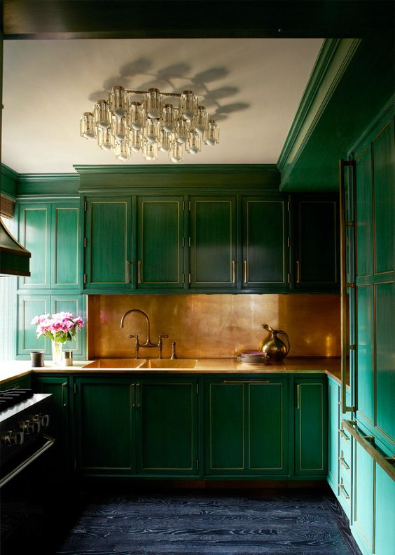 If you're especially brave, embrace this kitchen. Wow! The units are incredible. I love the copper splash back which brings light and draws your eye into the room. A dark blue floor completes the scheme. Picture: bykoket.com