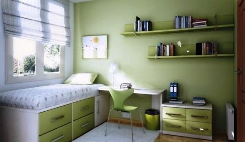 The furniture here really maximises space and the green colour is calming. A big window lets in lots of light and brightens the room.   Photo: rilane.com