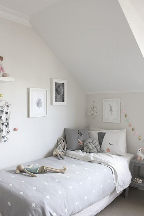 A lovely girl's room. Soft creams, greys and whites with touches of pink, gold and teal makes for a relaxing and personal bedroom.   Photo: justrealmoms.com.br