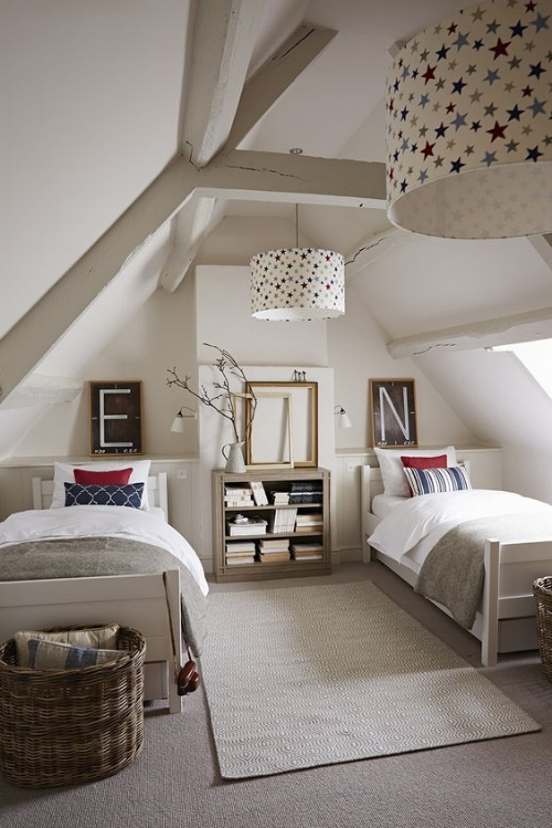 A cosy room for two to share. The different cushions on the bed and letter pictures on the wall above help personalise the areas. I love the touches of colour and the star print lamp shades bring everything together.    Photo: simshilditch.com
