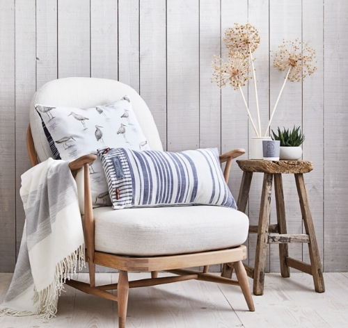 These soft furnishings from Sainsbury's in classic muted shades will evoke memories of the seaside. Pair with warm wood and you'll be dreaming of holidays.  - Woven Stripe Cushion  - Grey Stripe Throw  - Printed Oyster Catcher Cushion
