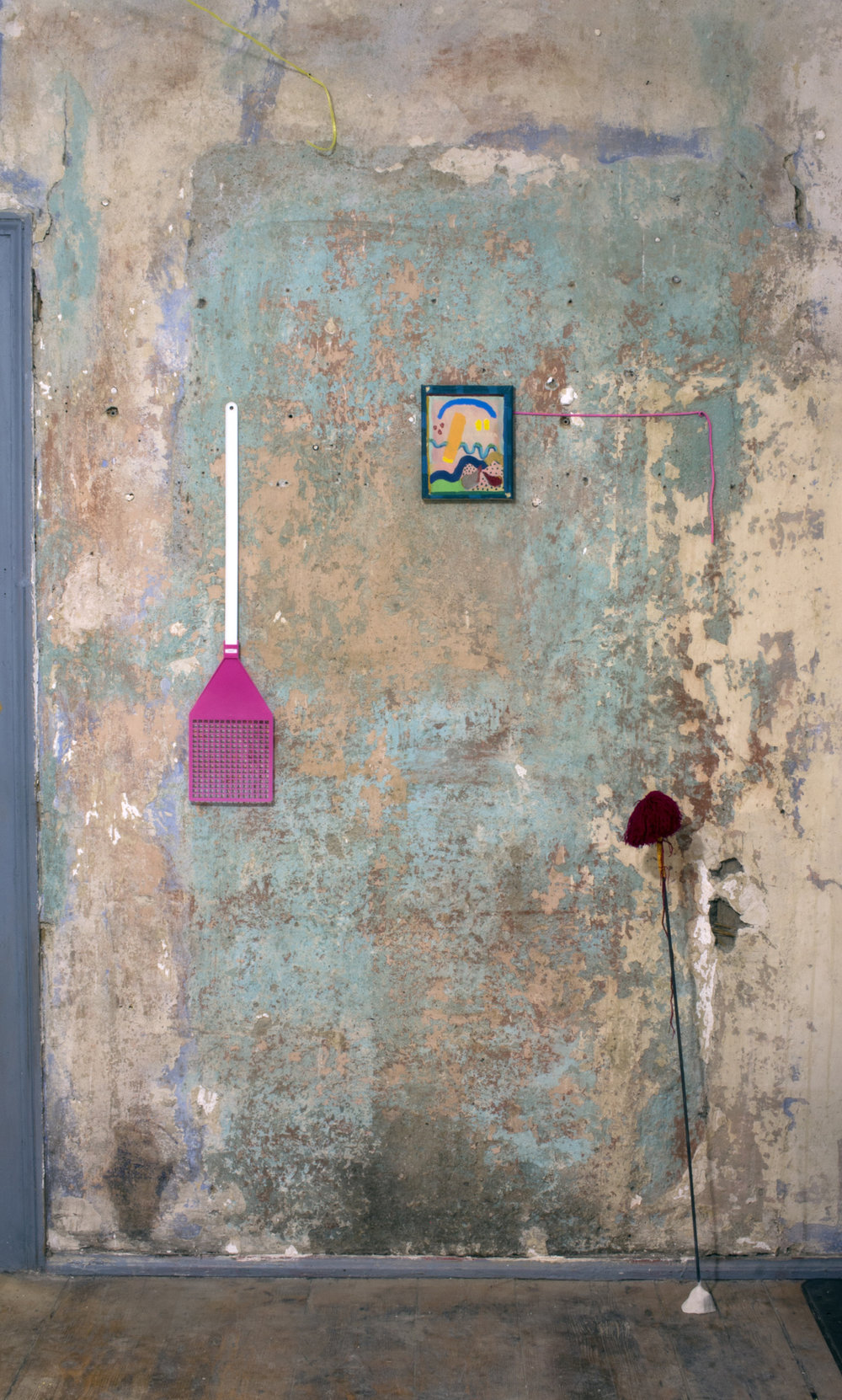 Space Invaders, painting by Jamison Egdar, pom-pom, 2016, chiapas thread, found rod and clay.