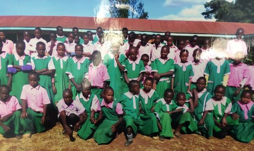 Two classes at our school exchange letters with Michaka Primary in Kenya. Attached is a picture of our pen pals. This letter exchange is facilitated by Farmers Helping Farmers. The organization connects a Canadian school to a school in Kenya. Our students also fundraise to help our penpals with essentials such as water.  This activity links to global citizenship as it creates an awareness of a different part of the world. It also encourages our students to fundraise and make a difference by providing water and other essentials to our penpals. Much of what we can help provide to them, we take for granted here.