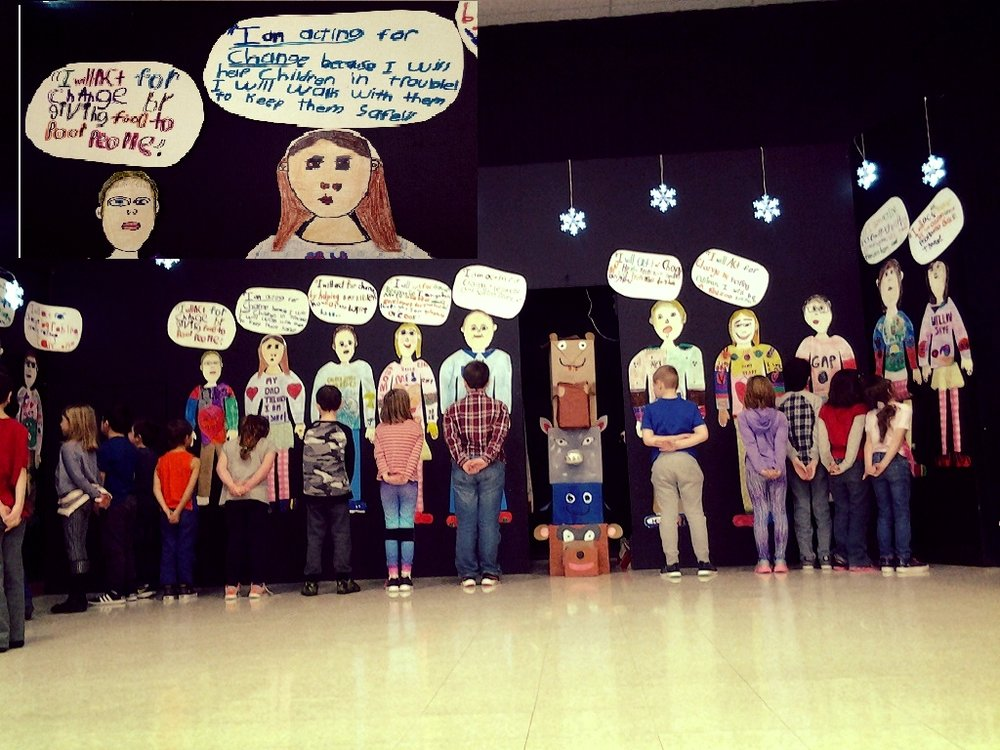 "Students created a life size representation of themselves. Prompted with ""I Will . . ."" students considered how they would like to make a positive change. They then created a speech bubble for their finished, statement. The works are displayed on the back wall of the school's stage.  Our actions are inspired by our thoughts. If we can change the way we think, we can begin to change the actions we take."