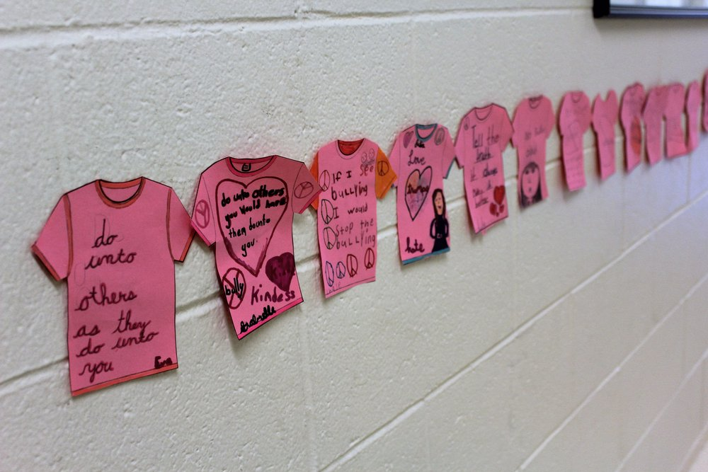 In celebration of Pink Shirt Day, all students were encouraged to wear the color pink. All classes focused on activities that involved reading, writing, viewing, and sharing experiences related to bullying. Bringing experiences to the forefront helps children to identify, relate, understand, and think about how they can help solve such issues for themselves and others. They also wrote positive anti-bullying messages on miniature pink shirts that were displayed in the hallways all around the building.  This activity connects to global citizenship because it reinforces the importance of acceptance of people's differences as well as the need for people to not only stand up for themselves, but to stand up for others as well. This is extremely important in a school, and world, where we want children and adults to embrace the differences rather than discriminate against them.