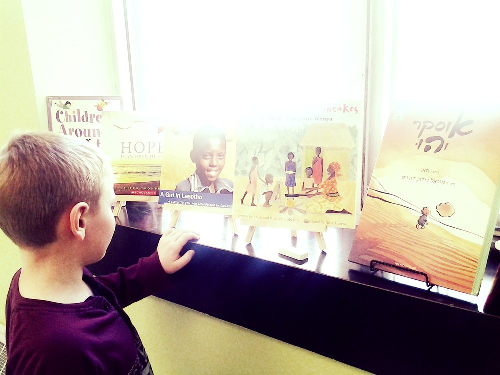 Students were exposed to books that teach diversity. Each day for 3 weeks we gathered as a class and read aloud from one of these books. Questions arose and discussions occurred.  Children's books can act like both mirrors and windows on the world. Mirrors in that they can reflect on children's own lives, and windows in that they can give children a chance to learn about someone else's life. We can learn about people who initially seem different, and get closer to them through their stories.
