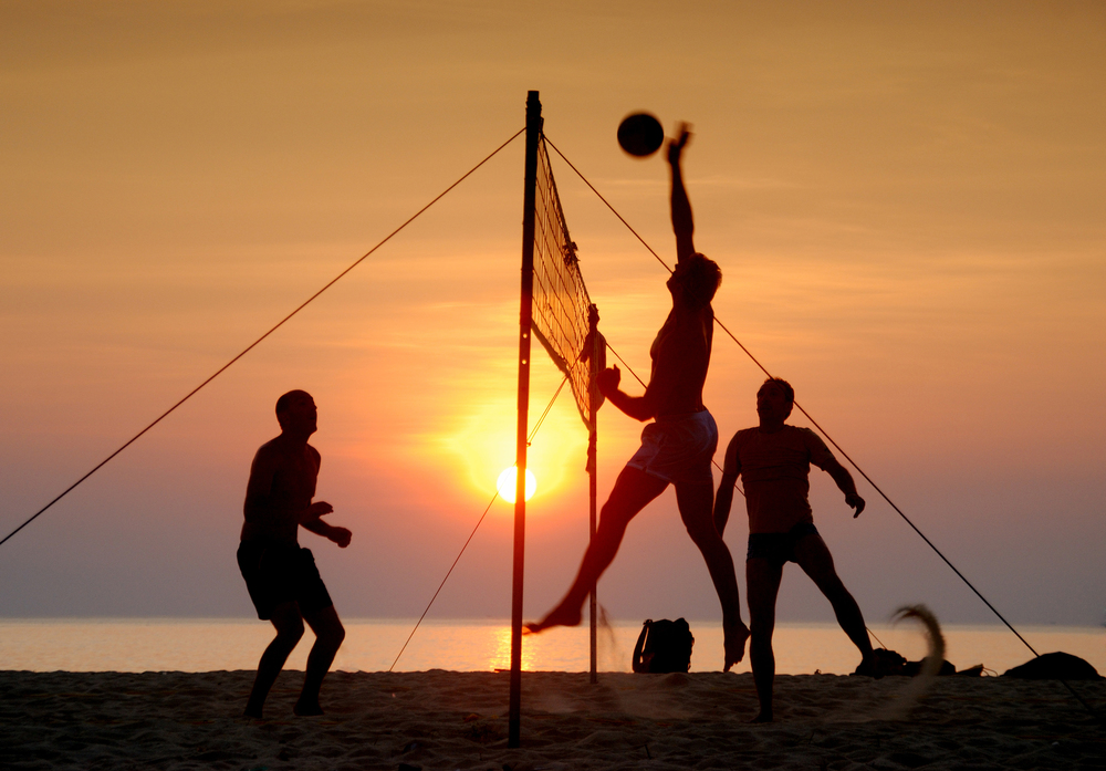 couple on beach playing volleyball enhanced.jpg