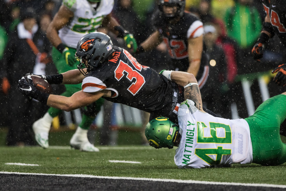 Oregon State Beavers running back Ryan Nall (#34) dives forward for the go-ahead touchdown while Oregon linebacker Danny Mattingly (#46) tries to stop him. The Oregon State University Beavers hosted the 120th Civil War against the University of Oregon Ducks on Saturday afternoon at Reser Stadium in Corvallis, Ore. The Oregon State Beavers beat the Oregon Ducks 34-24 breaking an eight-year losing streak.