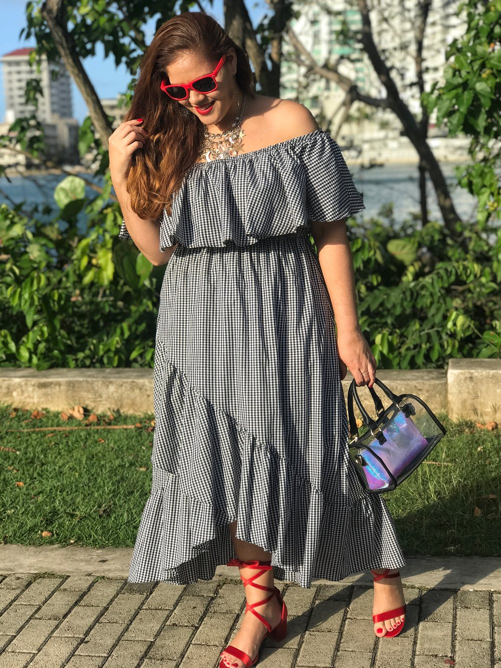 Off Shoulder Ruffled Gingham Dress  (50% Off Code: LOVEWALLET),  Red Sunglasses (Similar) ,  Star Multi Chain Necklace ,  Clear Bag (Similar) ,  Velvet Red Lace-Up Sandals