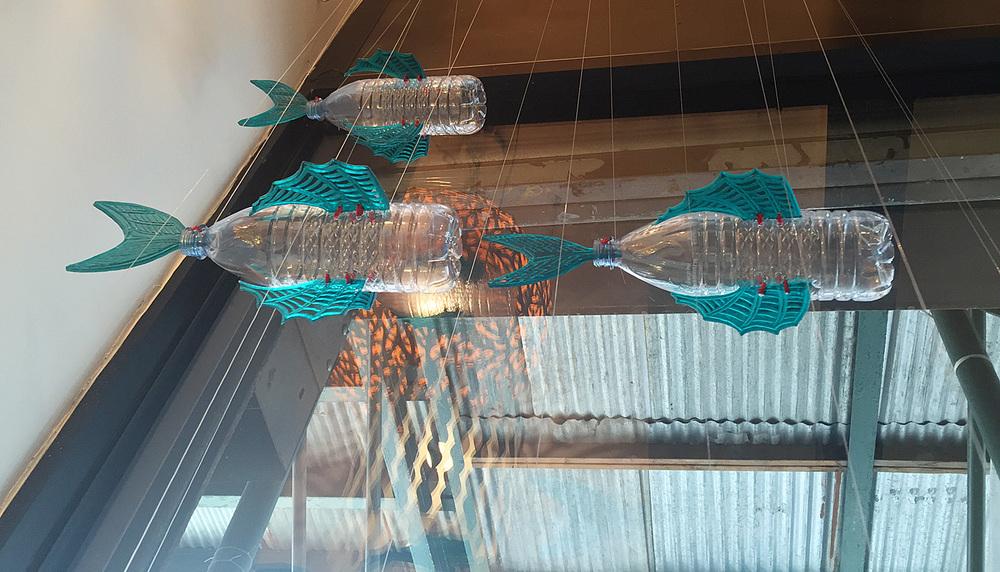 Bottled Ocean 2116 – Species Dasani    George Nuku, plastic bottles,  aqua marine plexiglass, red acrylic cord