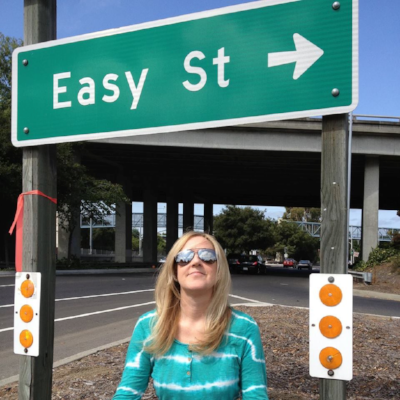 Kathy Hawkins standing under a sign