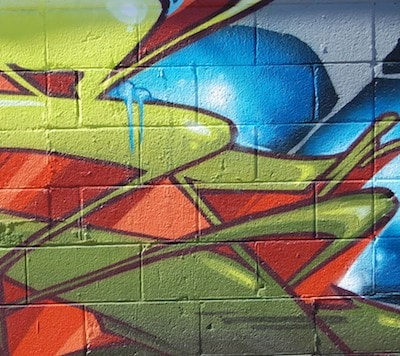 abstract graffiti shapes in blue, orange and green