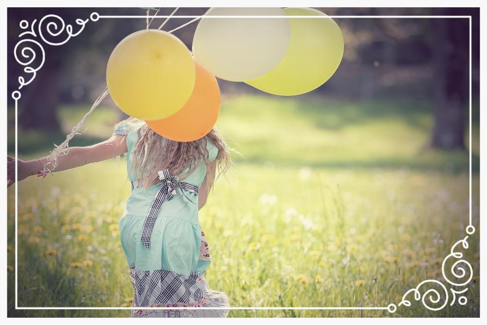 girl-holding-balloon-taste-success