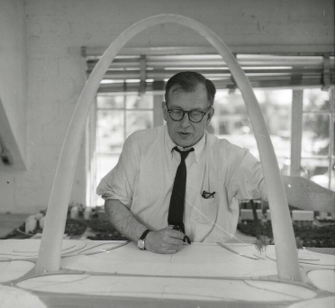 Eero Saarinen with a scale model of what would become the Gateway Arch