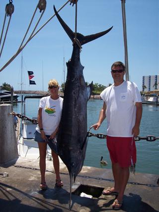 John, his wife Paula, and her first blue marlin in Mazatlan