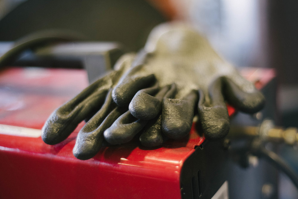 Work gloves protect while fabricating custom sheet metal products.