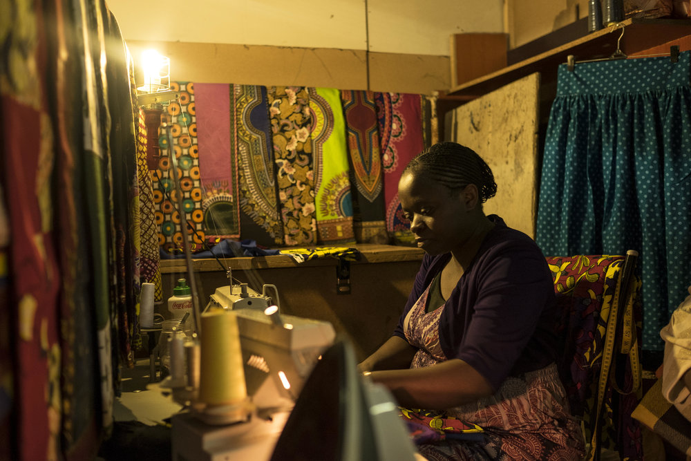 Anna migrated to South Africa from the Democratic Republic of Congo to flee the Second Congo War. She now runs a small dress-making business in Yeoville. Johannesburg, South Africa. November 8, 2016. (Miora Rajaonary/Native)