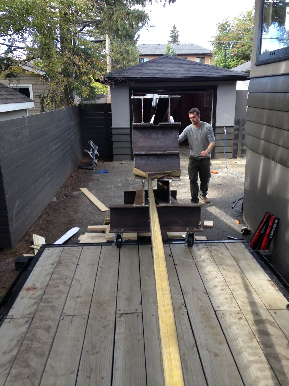 Getting Ronda (our ski press) onto the flatbed trailer...