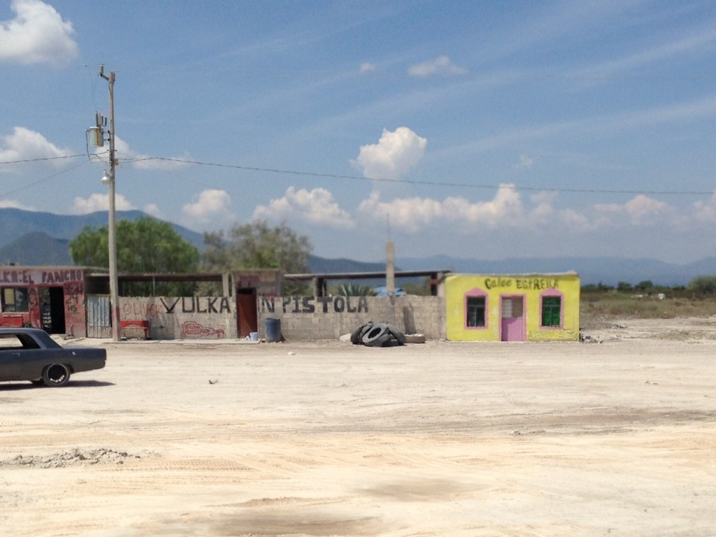 A typical Mexican strip mall on the road from Monterrey to Matehuala - a dirt parking lot fronting a vulka (tire repair shop), restaurant, and otherwise empty landscape
