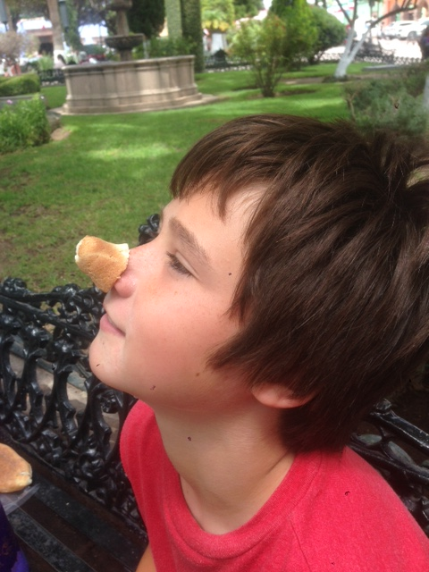 Here is J wearing the tail of the lizard as a war-trophy. He dubbed it Rudolph the bread-nosed reindeer.