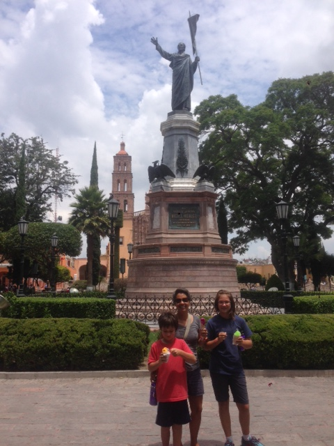 Statute of Hidalgo with the church in the background and Vanamos family in the foreground
