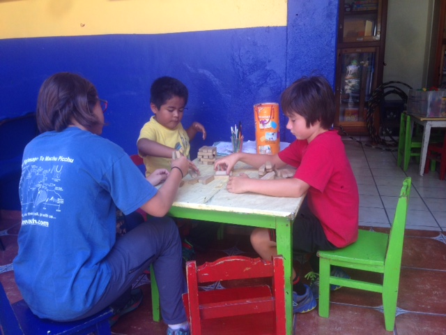 Coconut and J play Jenga with a boy, Cesar, that we met at a center which provides care for low income families. Oaxaca, which has a large indigenous Indian population, is one of the poorest states in Mexico.