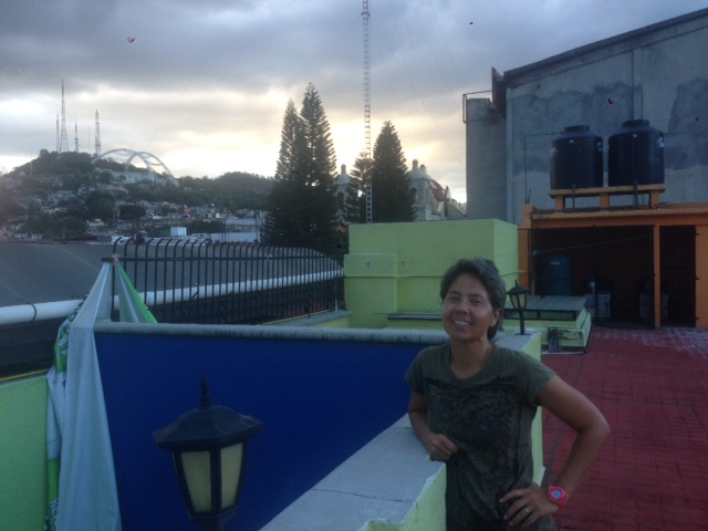 Here's a shot of R on the roof of the hostal where we spent our first night in Oaxaca with some of the city in the background. R took a picture of me with much more interesting cityscape behind me, but I wanted to get her some screen time so posted this picture that I took instead.