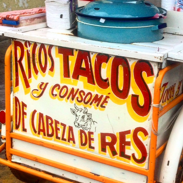 De cabeza de res means of the head of the cow. Ricos tacos means delicious tacos - maybe, but I'll never know!