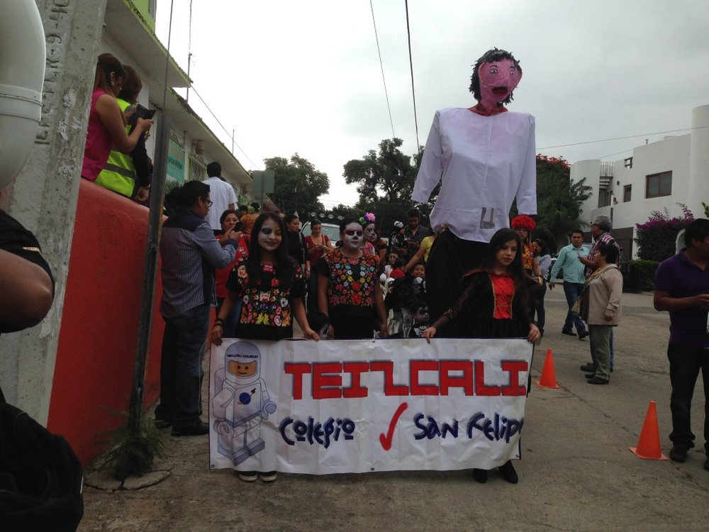 Colegio Teizcali in San Felipe del Agua, just outside Oaxaca City parades around the village for Dia de los Muertos. Notice 1980s Lego Space Guy, the school's mascot.
