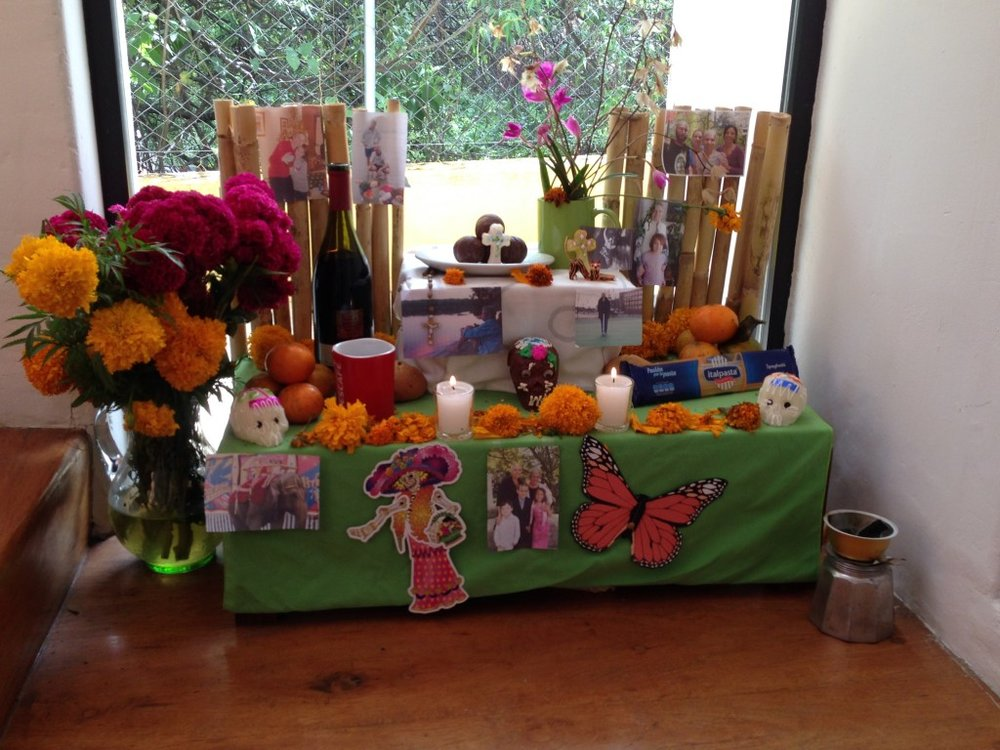 Our family Day of the Dead altar, constructed for Joanne Carlino, Paul's mom.  The altar is supposed to be 3 levels with images and items dear to the deceased.  (We ignorantly included photos of living people, which we later learned we weren't supposed to do.)  Copal, an incense from the resin of the copal tree, is burned on the altar and special sweet foods are placed on the altar, along with marigold flowers.