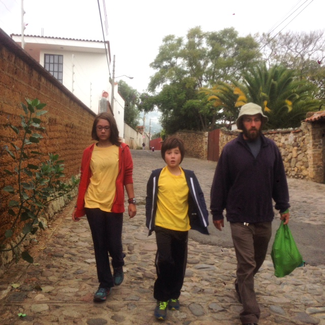 Coconut and J walking to their first day of Mexican school in uniform - yellow shirts and long pants. There was not too much protest so we think they were both somewhat excited about it.